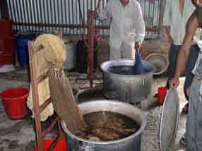 Yarn being dyed in vats